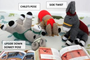 Knitted donkeys doing yoga