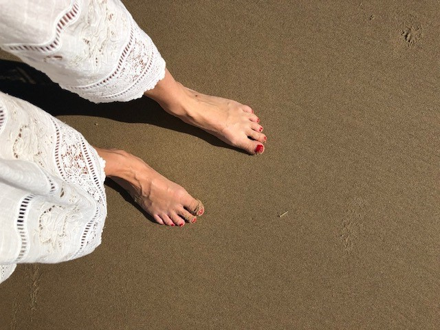 Feet on a beach